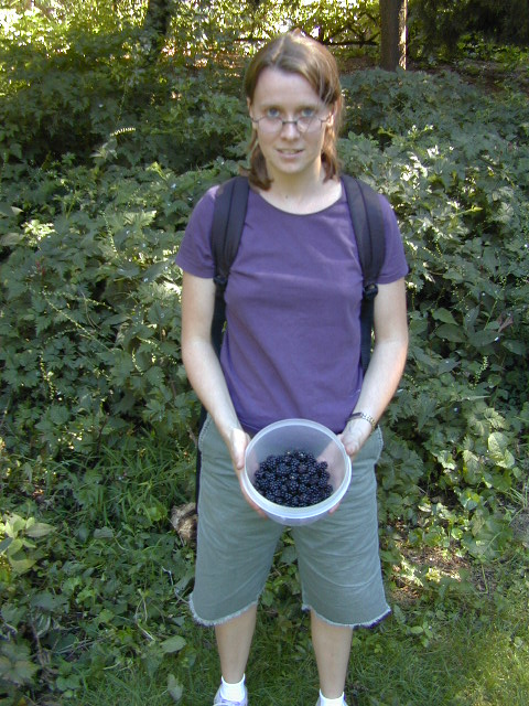 Elizabeth showing the blackberries she collected